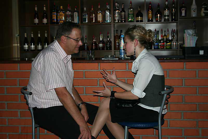 A photo of a man having a conversation with a Ukraine girl